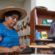Woman artist who uses the library's computers to photograph and market her hand-made hats.