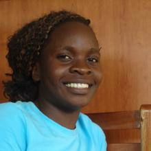 Babirye Gorretti, the young woman who opened her own computer school after business and computer skills training at Kawempe Youth Centre.