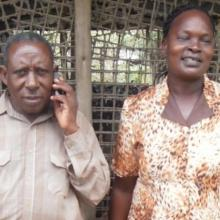 Two poultry farmers - a husband and wife team - at their farm.