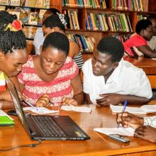 A group f librarians being trained in a library in Uganda.