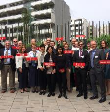 Group of delegates to WIPO holding placards with the names of their organisations.