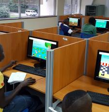 Children looking at computer screen with game