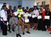 A group of learners holding certificates.