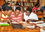 A group of librarians learning digital skills.,