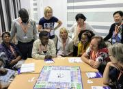 IFL guest blogger Jane Secker, standing, second from left, plays The Publishing Trap with EIFL General Assembly delegates.
