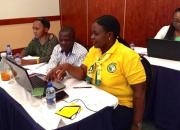 Zambian public librarians learning advanced computer skills.