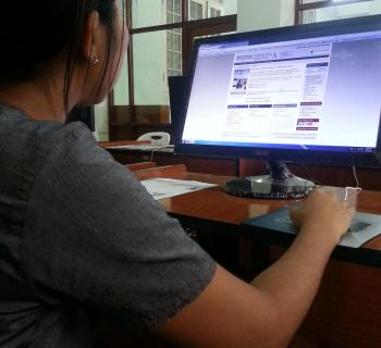 A student uses e-resources at the University of Yangon e-library in Myanmar,.