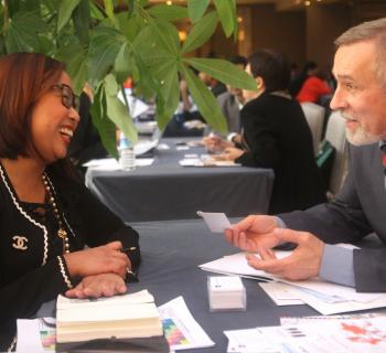 An EIFL publisher partner and an EIFL Coordinator from Belarus share a laugh during discussions.