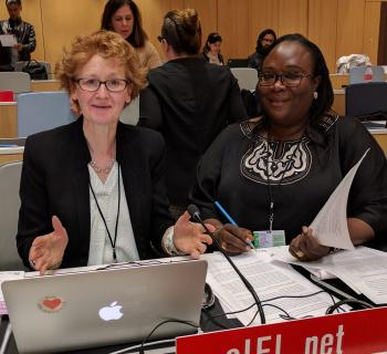 Photo of Teresa Hackett, EIFL Copyright and Libraries Programme Manager and Awa Cissé, EIFL copyright librarian in Senegal working together at EIFL's desk at WIPO's copyright committee meeting.