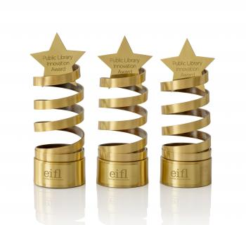 Three innovation award trophies - a spiral design, with a star on top.