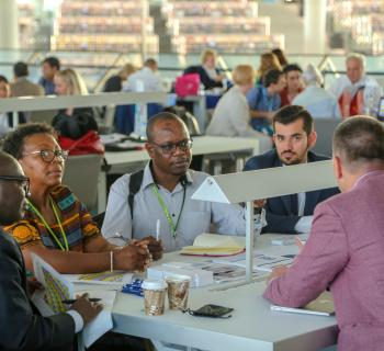 EIFL partner publishers and EIFL country coordinators meet during a 'speed dating' session at the EIFL General Assembly in Doha, Qatar, in 2018.