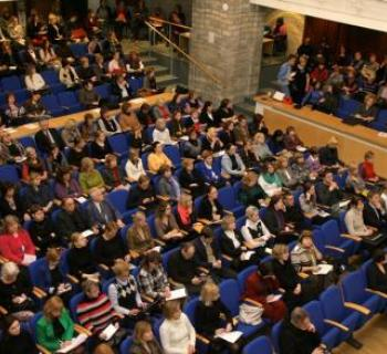 Photo, taken from above, of a large hall filled with seated people who are attending a conference in Estonia on digital copyright with librarians policy-makers, authors, publishers, and other memory institutions.