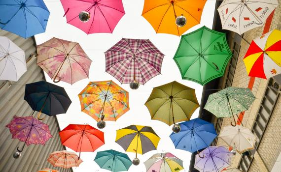 mage from the course - multicoloured umbrellas in the sky, representing data protection.