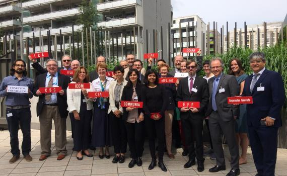 Group photo of representatives from library, archive and education sectors outside the WIPO building in Geneva.
