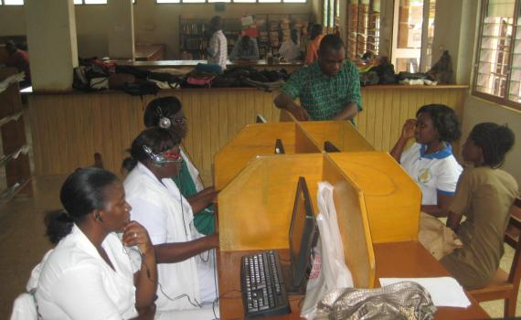Health workers learn to use computers in Northern Regional Library's maternal health corner.