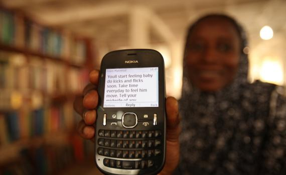 Women received advice and encouragement through the simplest of devices — their mobile phones. Photo credit: Iain Marlow
