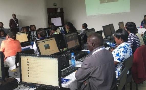 Training in progress. People using computers.