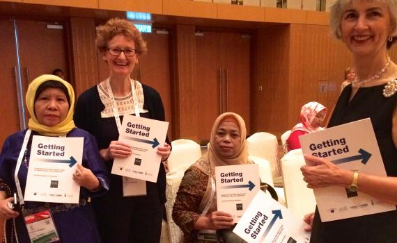 Teresa Hackett, EIFL Copyright and Libraries Programme Manager and Victoria Owen, University of Toronto Scarborough share copies of the new Marrakesh Treaty guide launched at IFLA WLIC 2018 in Kuala Lumpur.