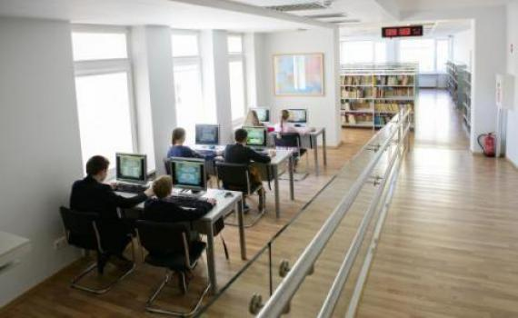 Children in 'A. & M. Miskiniai' Public Library playing the library's educational computer game, Issukis. Photo credit Gintare Zakarauskaite.