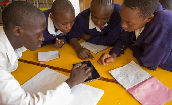 Children use tablet computers to access educational content linked to the school curriculum in Kibera Public Library.
