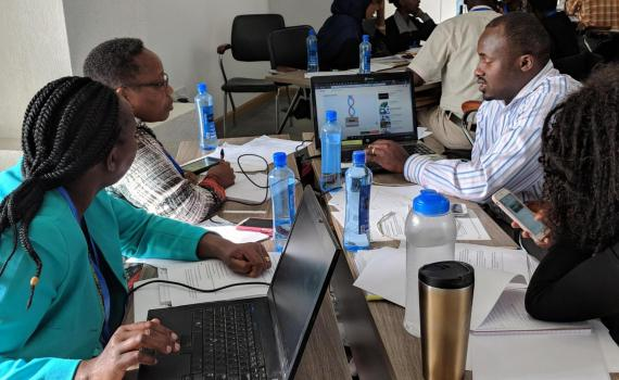 Kenyan public librarians working on media literacy presentation practice.